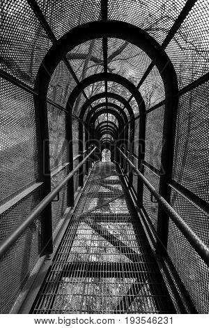 Greyscale Image Of An Elevated Metal Walkway