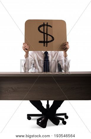 Businessman in the office holds a cardboard with the dollar symbol