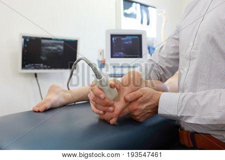 ultrasound of caucasian girl's foot - diagnosis, close up