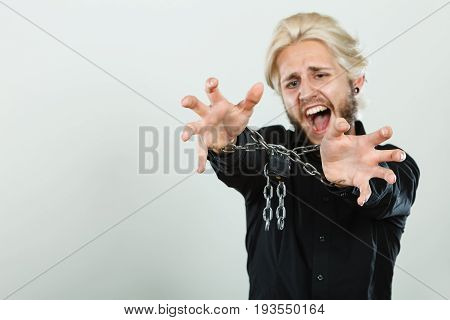 Screaming Man With Chained Hands, No Freedom