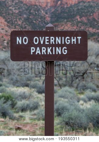 No Overnight Parking Sign in natural park area