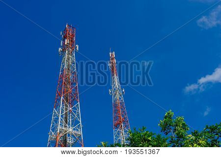 Antenna tower,Telecommunications tower in the afternoon bright sunlight and cloudy blue sky