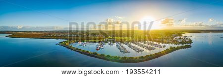 Aerial panorama of coastline and moored boats at sunset. Hastings Victoria Australia