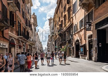 Rome Italy - August 18 2016: Tourists in Via del Corso a sunny day of summer. It is a main street in the historical centre of Rome.