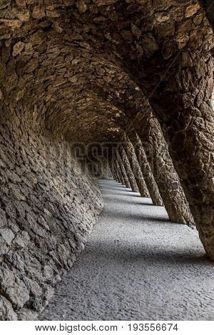 Tunnel passage with pillars from south at park Güell in Barcelona vertical