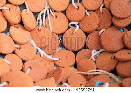 Group of handcraft small clay tag label.