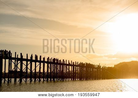 Ubein bridge World longest wooden bridge at sunrise at Taungthaman Lake Amarapura Mandalay Myanmar Burma