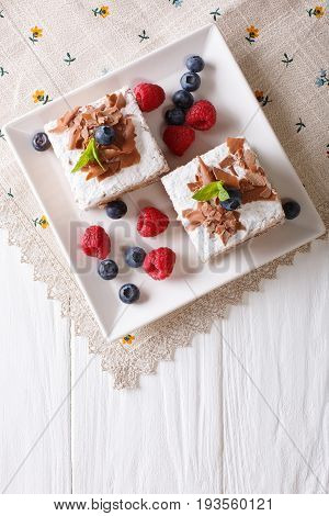 Chocolate Millefeuille With Berries Close-up On A Plate. Vertical Top View