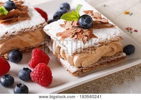 Beautiful Dessert: Chocolate Cake With Coffee Cream, Raspberries And Blueberries Macro. Horizontal
