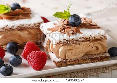 Millefeuille Chocolate, Decorated With Berries And Mint Macro On A Plate. Horizontal