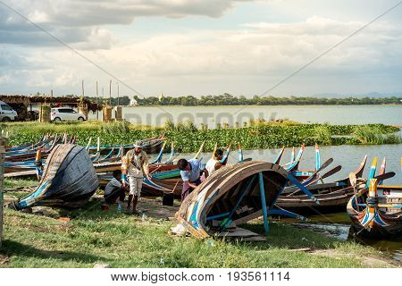 Amarapura Myanmar 25.06.2017 : wooden boat has been repaired by Myanmar local people at U Bein bridge Mandalay