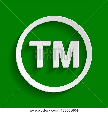 Trade mark sign. Vector. Paper whitish icon with soft shadow on green background.