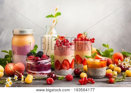Clean eating ideas for breakfast or snack. Assortment of  berry fruit  smoothies, juices and chia seeds pudding. Concept of healthy eating.