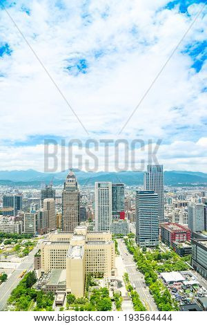 Asia Business concept for real estate and corporate construction - panoramic modern cityscape building bird eye aerial view under sunrise and morning blue bright sky shot in Taipei 101 Taiwan