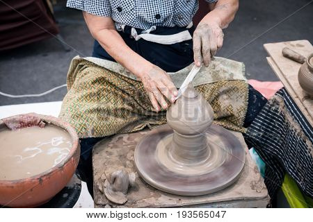 Shaping Decorative Clay Hollow Sculpture On Pottery Wheel With Knife