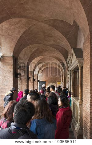 Rome Italy - October 01 2015. Tourists waiting to see the famous Mouth of Truth at Basilica of Santa Maria in Cosmedin in Rome Italy.