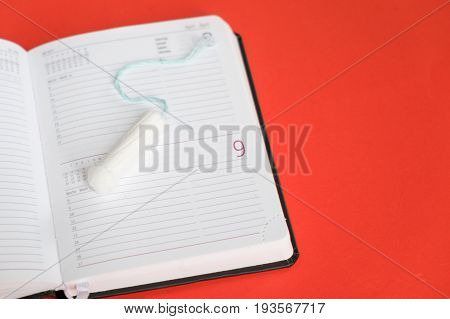 Menstruation Tampon Placed On An Organizer Page