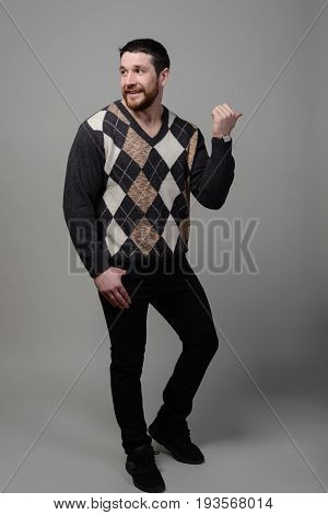 Concept. The Guy In The Checkered Sweater Catches The Car. Isolated On A Gray Background