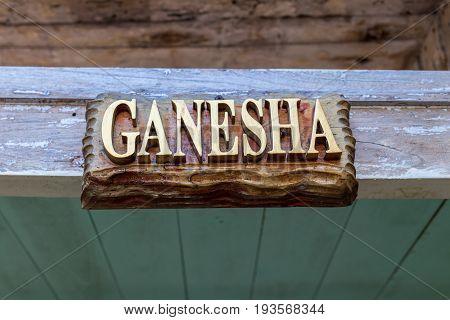Text Ganesha on a wooden plate. Hindu God Ganesha. Ganesha Idol.