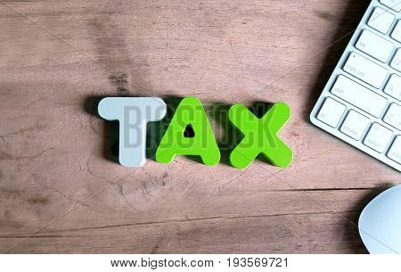 Tax with keyboard on office desk.Online tax payment concept.