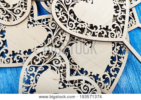 Wooden carved decorative hearts on a wooden background wedding decoration