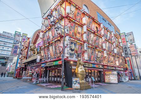 OsakaJapan - November 29 2015 : Shinsekai street with restaurant and advertises Hitachi. It is located in the Shinsekai district of Naniwa-ku OsakaJapan.
