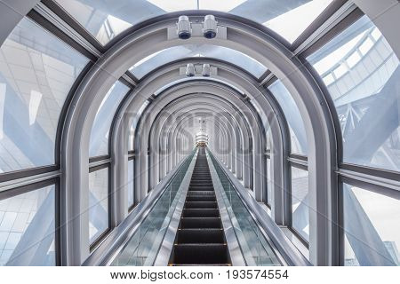 OsakaJapan - November 29 2015 : View of the spectacular escalator in Umeda Sky Buildinga modern high rise skyscraper in the Kita district of Osaka in Japan.