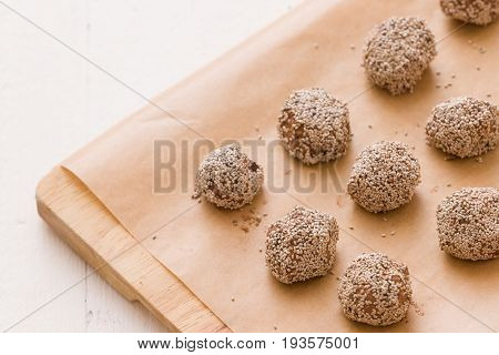 Dark chocolate coconut brownie energy bites.Oatmeal balls / Oats dates energy balls. Vegan sweet delicious nut cocoa balls. Healthy and tasty food concept