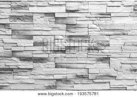 Brick wall background / Old gray Bricks Wall Pattern brick wall texture or brick wall background on day noon light for interior or exterior brick wall building and brick wall decoration texture.