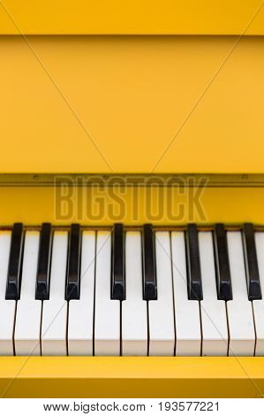Top view on yellow piano. Closeup of piano keys. Music concept