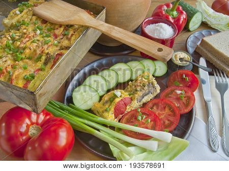 Vegetarian vegetable dish in country style on a wooden table top.