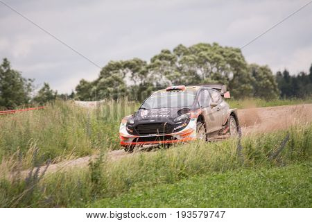 Mikolajki, Poland - 1 July 2017: Mads Ostberg and his codriver Ola Floene M-Sport World Rally Team in a Ford Fiesta WRC race in the 74nd Rally Poland, on July 1, 2017 in Mikolajki, Poland.