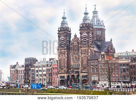 Amsterdam, Netherlands - March 31, 2016: Basilica church of St. Nicholas in Amsterdam near railway station