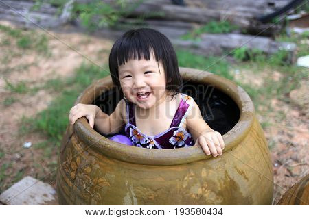 asian baby take a bath very funny.