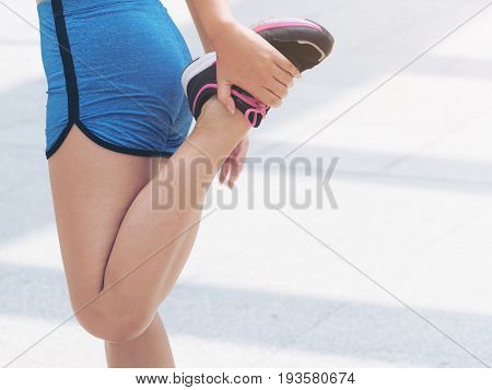 Sporty Woman Doing Leg Stretching
