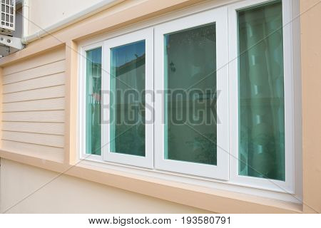 Window With Window Blinds On Wood Walls.