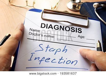 Staph Infection written on a diagnosis form.