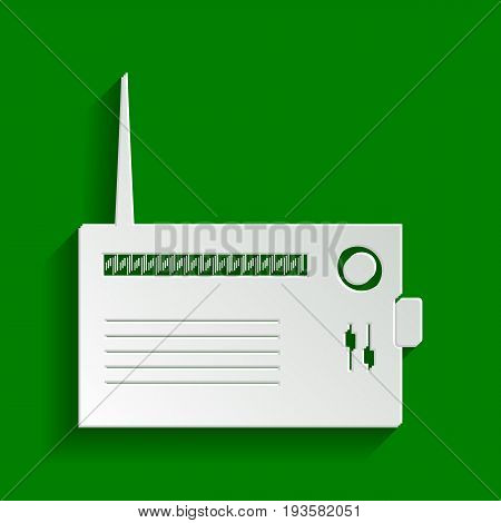 Radio sign illustration. Vector. Paper whitish icon with soft shadow on green background.