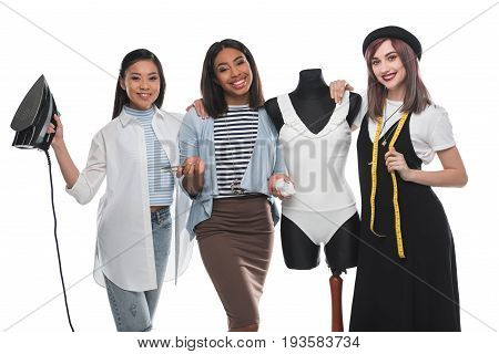 Beautiful Smiling Dressmakers Holding Tailor Tools While Working With White Bodysuit On Dummy