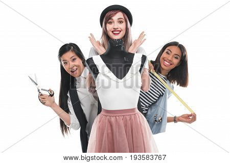 Multiethnic Group Of Beautiful Dressmakers Holding Scissors And Measuring Tape While Working With Du