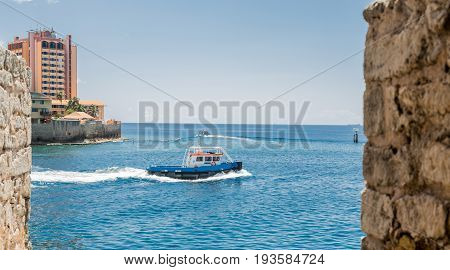 Pilot Boat Through Stone Wall on Curacao