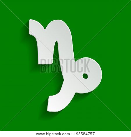 Capricorn sign illustration. Vector. Paper whitish icon with soft shadow on green background.