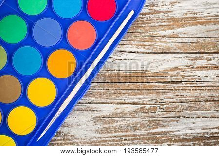 special watercolor on wooden background, education tools