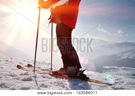 Low section of man in warm clothes on ski vacation