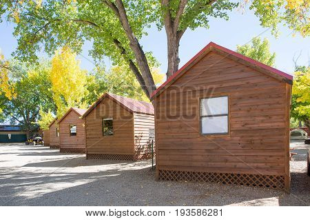 Log cabin in campground with autumn tree at Arches National Park