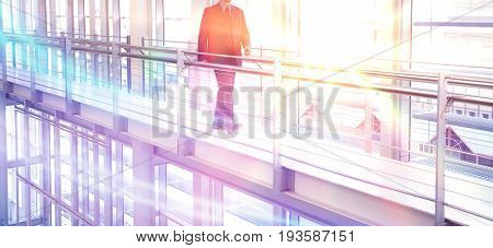Cropped photo of middle aged businessman walking by railing in modern office