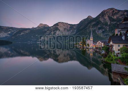 Scenic picture-postcard view of famous Hallstatt mountain village with Hallstaetter Lake in the Austrian Alps region of Salzkammergut Austria