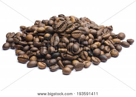 bunch of roasted coffee beans on white background