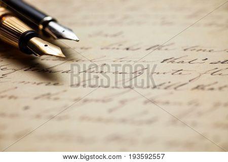 Fountain pens and an antique handwritten letter