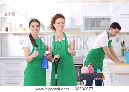 Cleaning service team working in kitchen